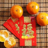 Red packets and mandarin oranges, golden Chinese letter means lu Stock Images