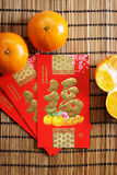 Red packets and mandarin oranges, golden Chinese letter means lu Stock Image