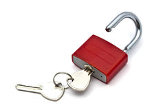 Red padlock. And key closeup on white background Stock Images