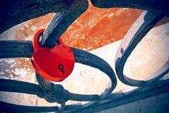 Red padlock on a black lace metallic lattice Royalty Free Stock Photos