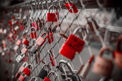 Red Padlock on Cyclone Fence Royalty Free Stock Photography
