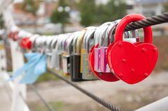 Red padlock in the shape of heart. Symbol of love Stock Photography