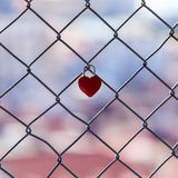 Red padlock in the shape of heart Stock Photos