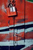 Red padlock on wooden door. Red padlock on wooden colorful door stock photography