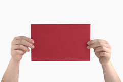 Red page in the hands. Of a white background royalty free stock photos