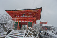 Red Pagoda At Kiyomizu-dera Temple With Tree Covered White Snow Background. Stock Photos