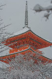 Red Pagoda At Kiyomizu-dera Temple With Tree Covered White Snow Background. Stock Image