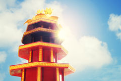 Red pagoda on blue sky. Red pagoda over bright blue sky Royalty Free Stock Photos