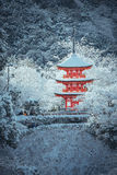 Red Pagoda at Kiyomizu-dera temple with tree covered white snow background. Royalty Free Stock Images