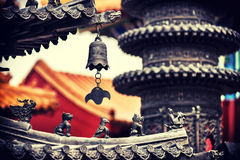 Red pagoda roof and Asian architectural details in oriental garden. At summertime royalty free stock photo