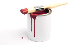 Red Paint. Tin of red paint and paint brush Royalty Free Stock Photos