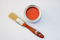 Red Paint. A bucket of red paint with a paint brush next to it Stock Images