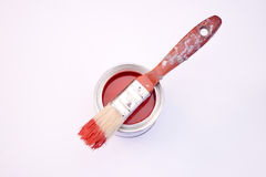Red Paint. A bucket of red paint with a paint brush resting on top stock images
