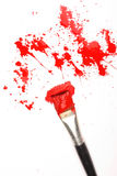 Red paint. Splashes of red paint and brush stock photo