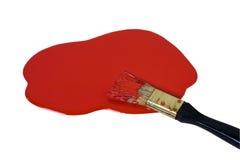 Red paint. Splash and paintbrush Stock Photos