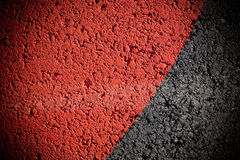 Red paint in asphalt texture Royalty Free Stock Photos