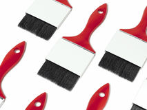 Red paint brushes with blank labels. 3d rendering. Red paint brushes with blank labels isolated on white. 3d rendering Royalty Free Stock Photography