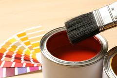 Red paint can, brush and color palette on table, closeup. Space for text stock photo