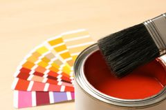 Red paint can, brush and color palette on table, closeup. Space for text royalty free stock photos