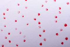 Red paint dots on a white background. On display royalty free stock photos