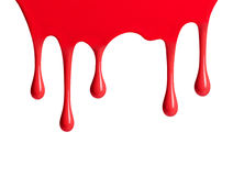 Red paint dripping isolated over white. Background Royalty Free Stock Images