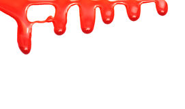 Red paint dripping isolated on white paper stock photo