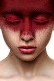 Red paint on face of beauty model Stock Images