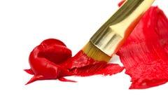 Red paint gold brush Stock Photo