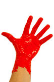 Red paint on hand Stock Images