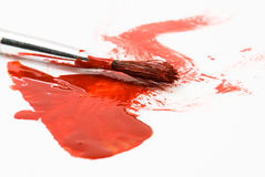 Red paint and old used brush Royalty Free Stock Photos
