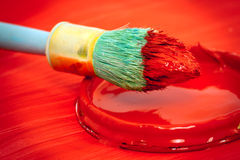 Red paint and paintbrush Stock Image