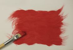 Red paint with paintbrush Royalty Free Stock Images
