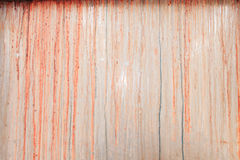 Red paint pouring down a window Royalty Free Stock Photo