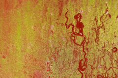 Red paint rusty metal plate gold particle surface oxidized Stock Photography