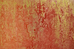 Red paint rusty metal plate gold particle surface oxidized Royalty Free Stock Images