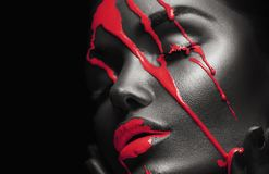 Free Red Paint Smudges Drips From African American Woman Face, Lips, Eyes. Lipgloss Dripping From Sexy Lips Royalty Free Stock Photos - 160998208