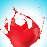 Red paint splash. On light blue background royalty free stock image