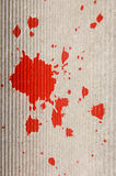 Red paint splash. On gray background stock photos