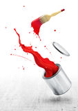 Red paint splash. Ing out from its bucket with paintbrush royalty free stock image