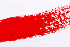 Red paint splash. On a white paper stock photography