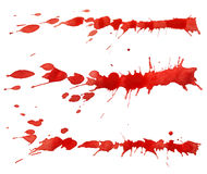Red paint splashes. Isolated on white background Stock Photos