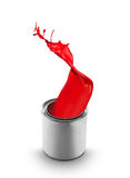 Red paint splashing out of can. On white background royalty free stock image