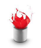 Red paint splashing out of can. On white background royalty free stock photos