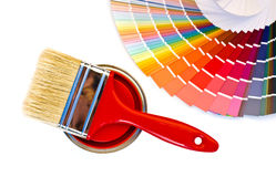 Red paint and swatch. Samples with different shades of red and can of red paint with a brush royalty free stock image