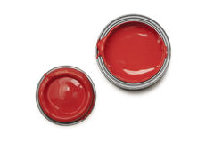 Red paint tin. Open red paint tin and lid shot from above against a white background Stock Photo