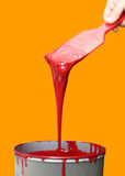 Red Paint in a tub over Yellow. Red Paint stock photography