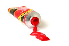 Red Paint Tube. Red Oil Paint Tube in white background Stock Photo