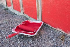 Red paint updating an old barn shed. Red paint going upd upda updat updati updatin updating old barn shed royalty free stock images