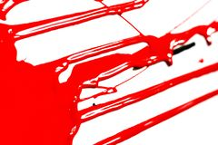 Red paint on a white background. Red paint drips on a white background. Paint flows royalty free stock photography