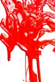 Red paint on a white background. Thick red paint on a white background. Paint flows stock images